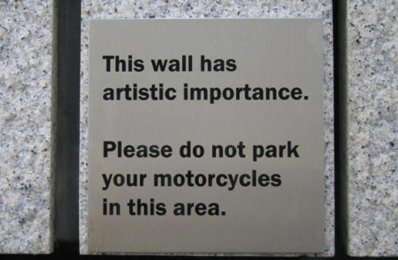 Detail of warning sign on Rupert Spira's mural 100 New Bridge Street, this wall has artistic importance