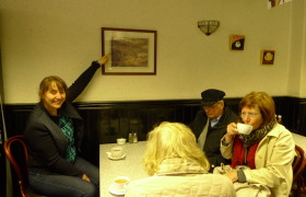 Tour leader Vanessa showing the photo of Carr's Papers in the local cafe