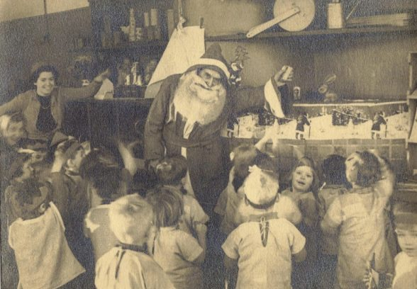 Christmas in the nursery at Three Lane Ends Infants' School, Whitwood Mere, Castleford, Yorkshire, Oliver Hill, c. 1943